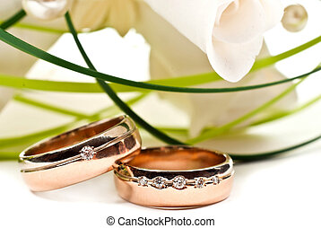 Wedding rings - Pair of golden wedding rings with rose ...