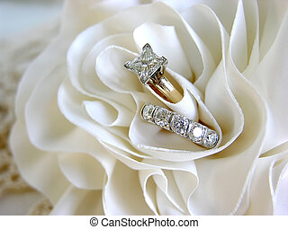 Wedding Rings - diamond wedding rings in the folds of the...