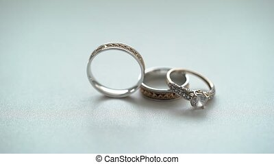 Wedding rings rolls on white background