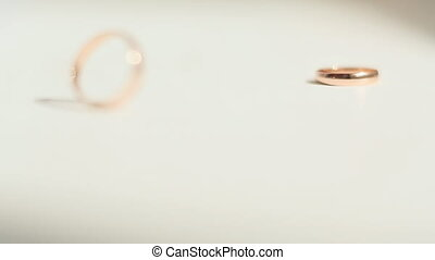 Wedding rings rotate on a white background
