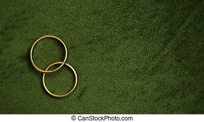 Wedding rings rotating with textured background