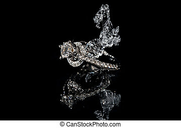 Wedding Rings Sinking in Water, Black Background