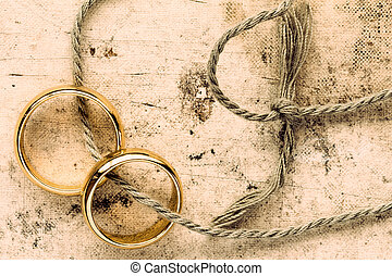 Wedding rings tied with string