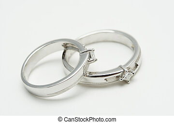 Wedding rings - Two white gold wedding rings on silver...