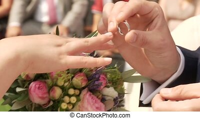 Wedding Rings - video footage of a wedding with putting on...