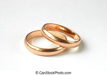 Wedding rings on a white background.