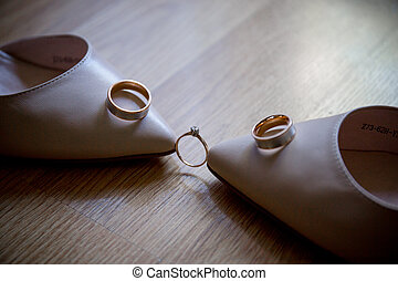 wedding rings with shoes of the bride