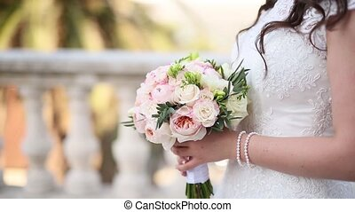 Wedding roses and peonies in the hands of the bride. Wedding...