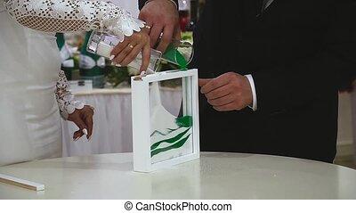 Wedding sand ceremony , close-up hands bride and groom