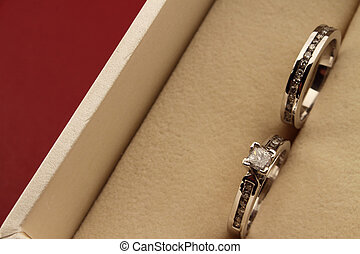 wedding set in case - photo of diamond solitaire ring and...