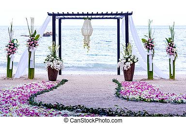 Wedding setting venue on the beach .