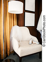 Wedding shoes on the white chair