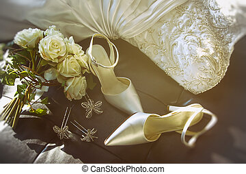 Wedding shoes with bouquet of roses on chair - Wedding shoes...