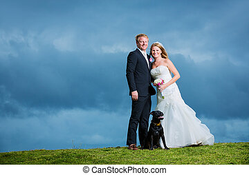 Wedding Couple, Happy bride and groom posing with their dog