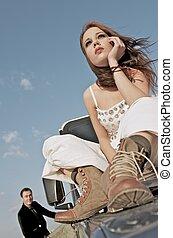 Wedding - Bride sitting on the car hull