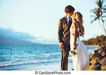 Wedding - Romantic Wedding Couple Kissing on the Beach at...
