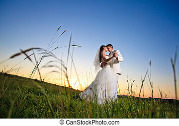 Wedding sunset - Wedding couple dansing in mountain hill on...
