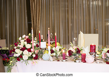 Wedding table decor with red flowers and candles