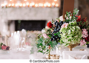 Wedding table decoration with the red and pink flowers,...
