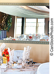 Wedding table place setting with reflection in mirror
