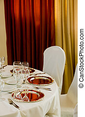 wedding table set for dining with silver plates
