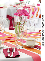 Wedding table set for fun dining during a banquet event -...