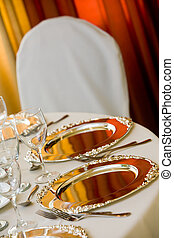 wedding table set with silver platters for dining
