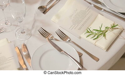 Wedding table setted for celebration: plates, forks, white...