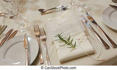 Wedding table setted for celebration: plates, forks, white...