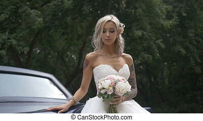 Wedding. The bride posing for photographer