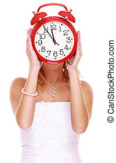 Wedding Time. Portrait bride with clock covering her face. -...