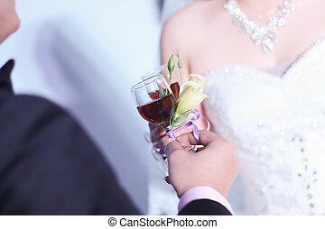 wedding toast between bride and groom