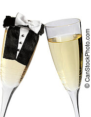 Wedding Toast - Champagne glasses during toast, one with...