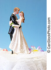Wedding Topper - A wedding cake topper on top of the...