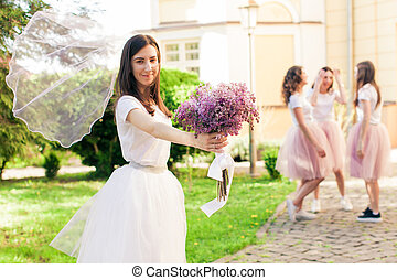 Wedding veil of Bride-to-be ifluttering in the wind outdoors...