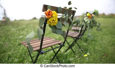 wedding venue, chairs decorated with flowers. High quality FullHD footage