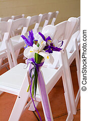 Wedding Venue Chairs - White wedding venue chairs are setup...