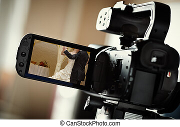 Wedding video - camcorder, selective focus on screen,...