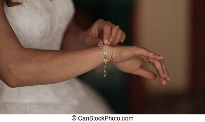 Wedding. Wedding day. Luxury bracelet on a hand of the bride before the wedding. Wedding accessories.