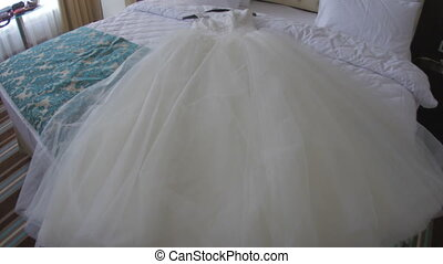 Wedding white dress on bed