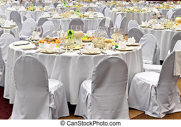 Wedding white reception place ready for guests.