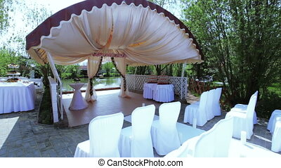 Weddings ceremony at river - Camera on steadicam flies under...