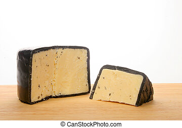 Wedge of Cheddar cheese - Wedge of mature farmhouse cheddar...