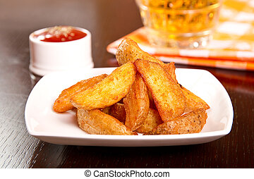 Wedges with herb rub and ketchup