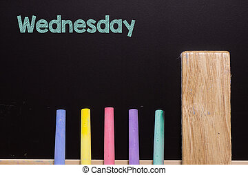 Wednesday on Blackboard with chalk and eraser