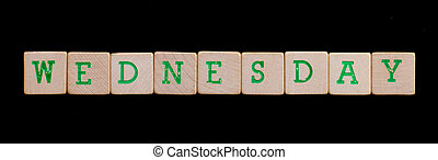 Wednesday spelled out in old wooden blocks