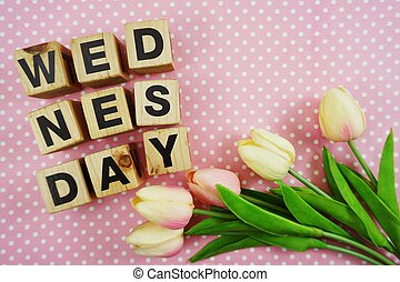 wednesday word made from wooden cubes with letters alphabet