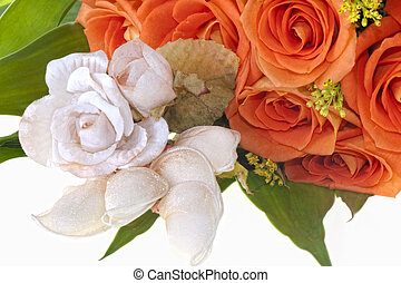 weeding Favors and orange roses on white lace