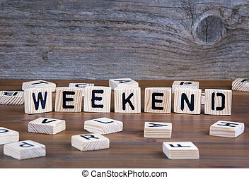 Weekend from wooden letters on wooden background