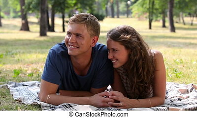 Weekend in park - Lovely young lovers enjoying their weekend...